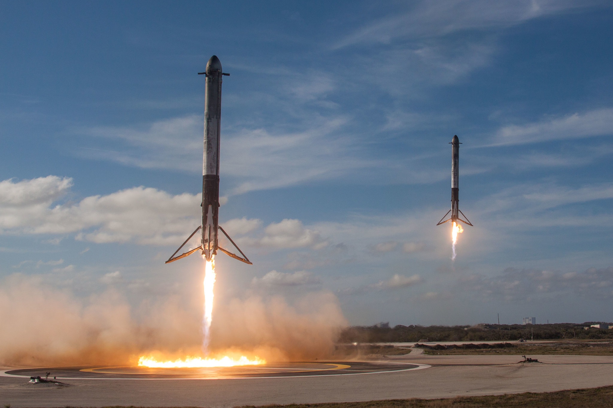 Side boosters from SpaceX Falcon Heavy Rocket land at LZ-1 and LZ-1.