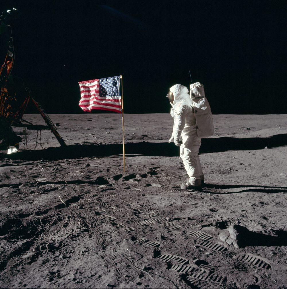 Buzz Aldrin solutes flag following Apollo 11 landing.