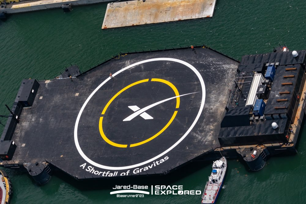 A Shortfall of Gravitas and SpaceX logo painted on ship deck.